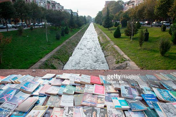 Used books for sale on bridge across canal