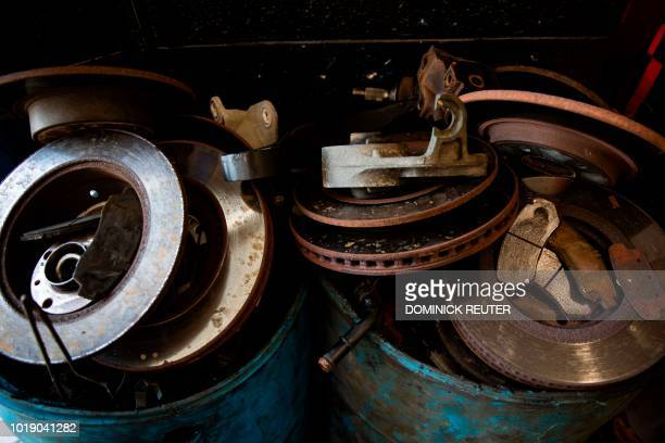 Used brake rotors are seen at the Girls Auto Clinic garage in Upper Darby Pennsylvania on August 7 2018 On the outside the auto body shop looks like...