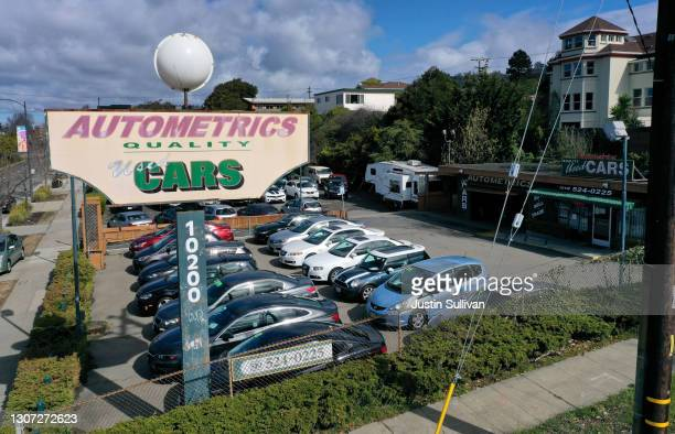 Used cars sit on the sales lot at Autometrics Quality Used Cars on March 15, 2021 in El Cerrito, California. Used car prices have surged 17 percent...
