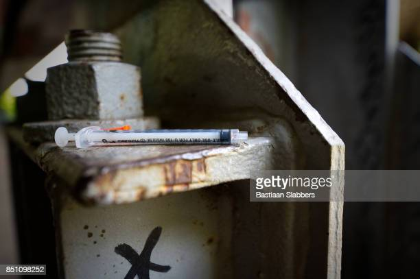 used heroin syringe - plague stock photos and pictures