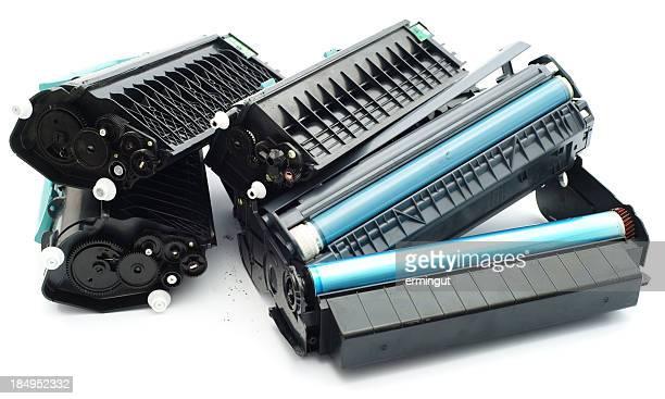 Used laser printer cartridges pile isolated on white