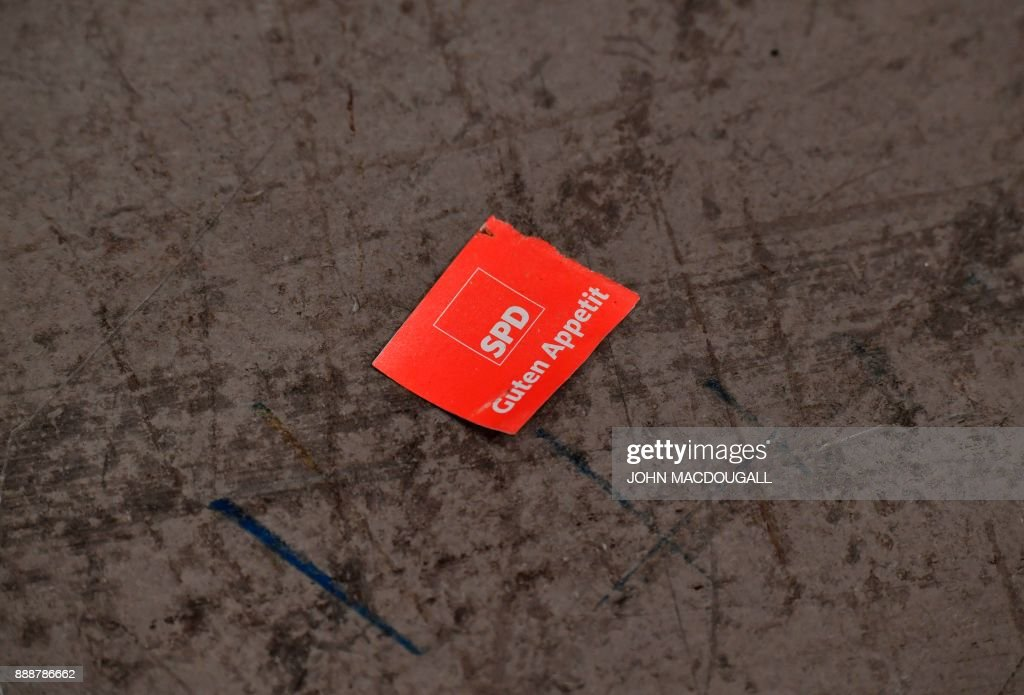 A used lunch ticket lays on the ground during the last day of the Social Democratic Party (SPD) party congress on December 9, 2017 in Berlin. Germany's Social Democrats, the country's second strongest party, agreed to kick off exploratory talks with Chancellor Angela Merkel's conservatives that could lead to a new coalition government early next year. / AFP PHOTO / John MACDOUGALL