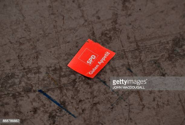 Used lunch ticket lays on the ground during the last day of the Social Democratic Party party congress on December 9, 2017 in Berlin. Germany's...