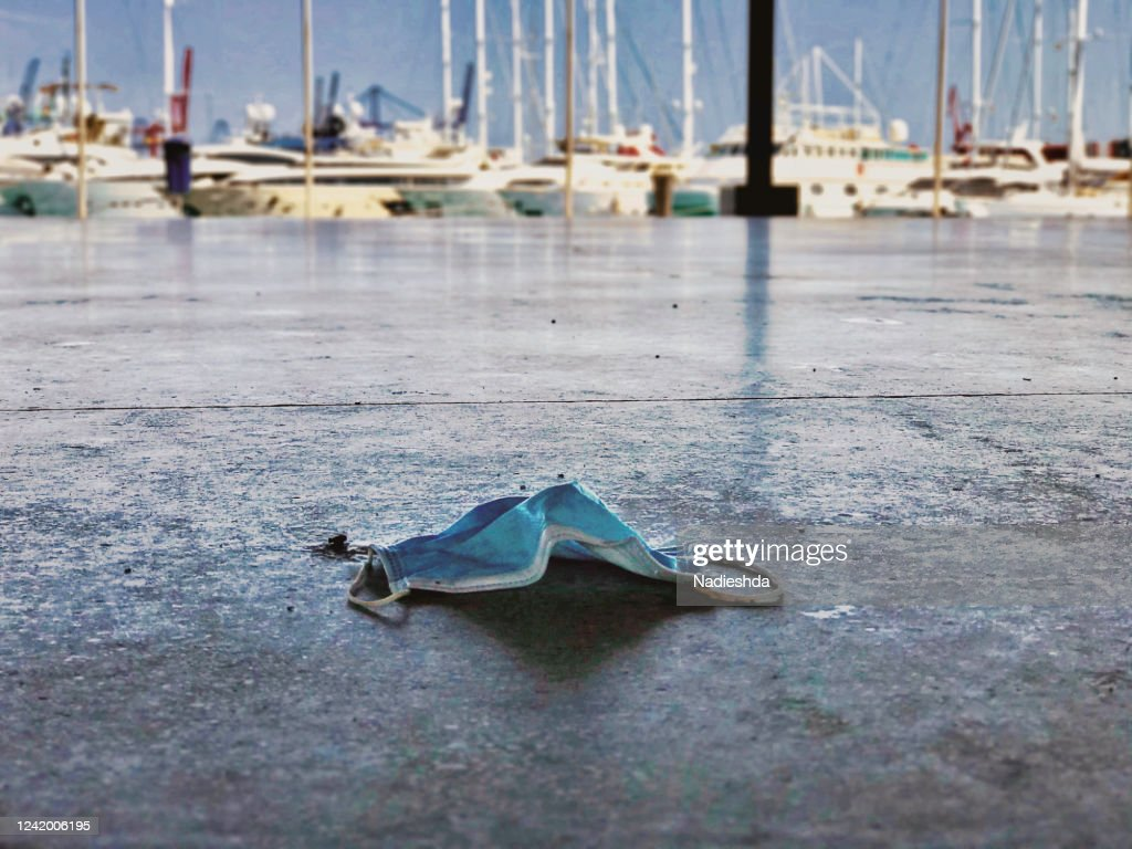 A used mask littering streets of Valencia, Spain : Stock Photo