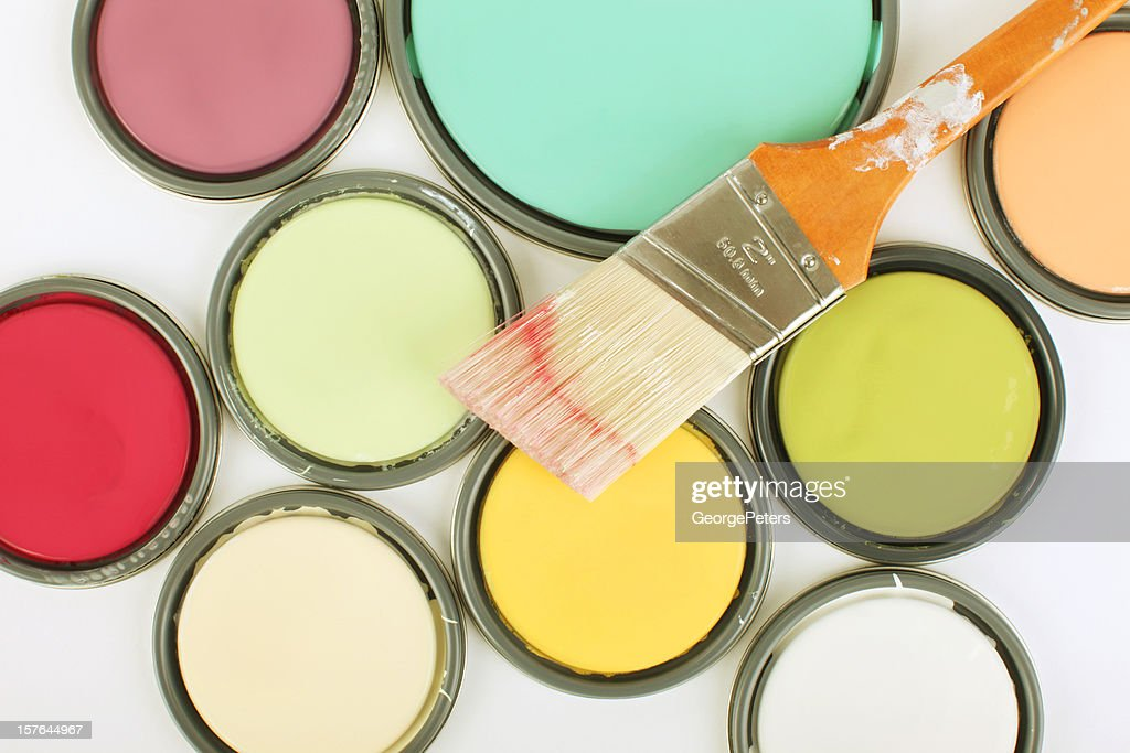 Used paintbrush on top of paint can lids : Stock Photo