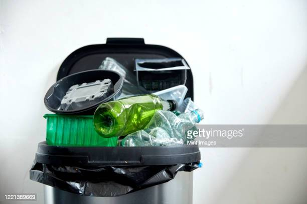used plastic containers filling up kitchen dustbin - 使い捨て製品 ストックフォトと画像
