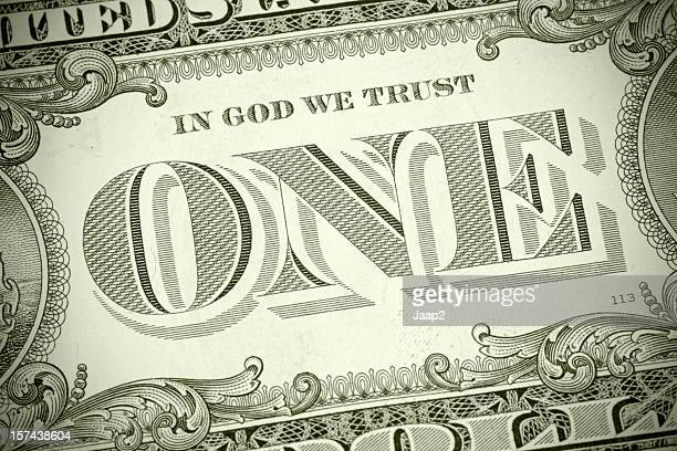 Used US one dollar banknote with emphasis on 'ONE', toned