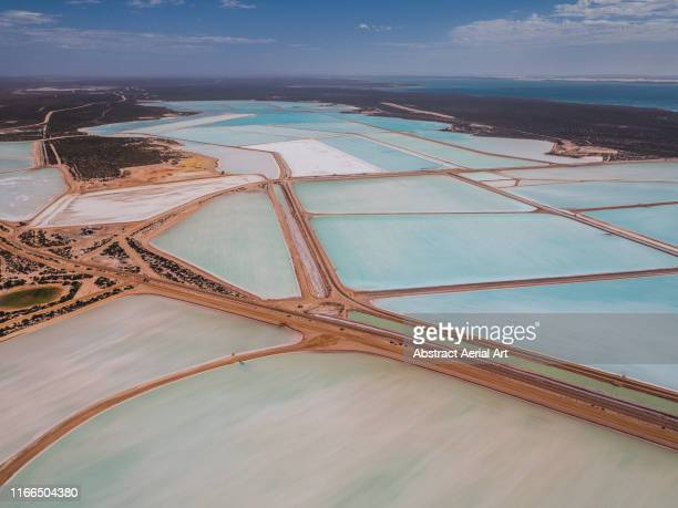 useless loop salt evaporation ponds as seen from above, shark bay, australia - ソルトポンド ストックフォトと画像
