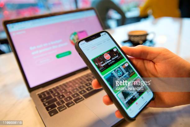 User of the Karma food-sharing app browses foods available from the Coco Di Mama food outlet chain of stores -- a partner of Karma -- in this posed...