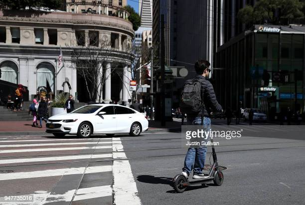 A user rides a Bird scooter on April 17 2018 in San Francisco California Three weeks after three companies started placing electric scooters on the...