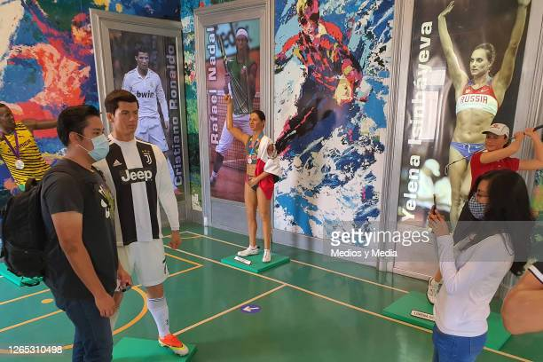 User takes a photo with the wax figure of Cristiano Ronaldo in 'Museo de Cera CdMx' following all the preventive measures of the Coronavirus on...