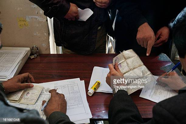 KABUL AFGHANISTAN – JANUARY Users and employees of the traffic department in Kabul process the paperwork to renew driving licenses Obtaining a...