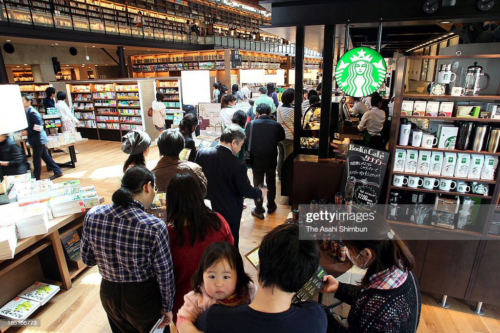 Users queue at a coffee shop Starbucks opens at the renovated Takeo City Library during a preview on March 31, 2013 in Takeo, Saga, Japan. The city outsourses the library operation to Japan's video rental and bookstores chain Culture Convenience Club Co, that are know as the operator of 'Tsutaya', drawn attention for this new and unique attempt.