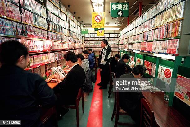 Users read manga books at a Manga Kissa or Manga cafe on February 10 1999 in Tokyo Japan