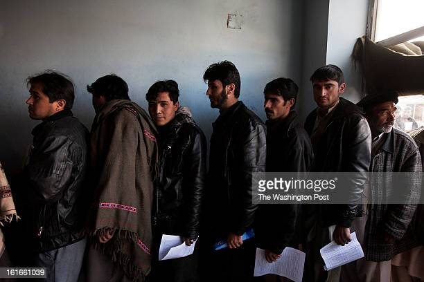 KABUL AFGHANISTAN – JANUARY Users wait in line inside the traffic department in Kabul Obtaining a vehicle registration or renewing a driver's license...