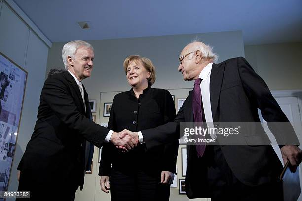 German historian Fritz Stern and Bob Kerrey President of the New School For Social Research shake hands during the presentation of honorary degree of...
