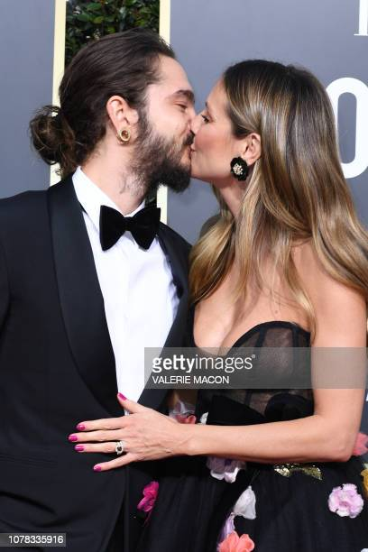 USGerman model Heidi Klum arrives with her fiance musician Tom Kaulitz for the 76th annual Golden Globe Awards on January 6 at the Beverly Hilton...