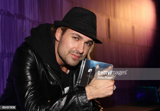 German violinist David Garrett poses for the photographers during a press conference in order to promote his new album 'Encore' and his upcoming tour...
