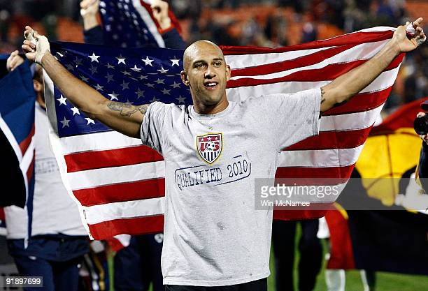 Goalkeeper Tim Howard celebrates with teammates after the U.S. Tied the score in the final minute against Costa Rica in their FIFA 2010 World Cup...