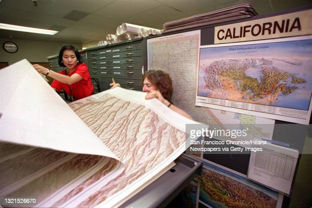 At left is Lily Chow and at right is Claudia Wornum looking through maps of Mesa Verde National Park, Colorado. Their first visit to map sales,...
