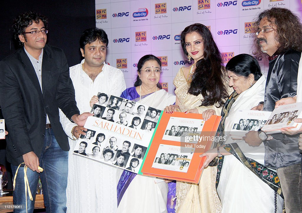Usha Mangeshkar Rekha Lata Mangeshkar and Hariharan during the music launch of album `Sarhadein` by Sa Re Ga Ma and Radio City at Taj Lands End Mumbai
