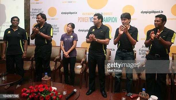 Usha MC Mary Kom Vishvanathan Anand Geet Sethi Leander Paes at the launch of the 'Power Your Champion' programme in New Delhi on September 23 2010