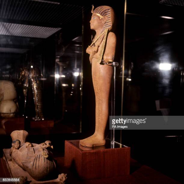 Ushabti figure of King Tutankhamun at the British Museum exhibition Carved in wood the likeness has the lower part of the body shrouded like a mummy...