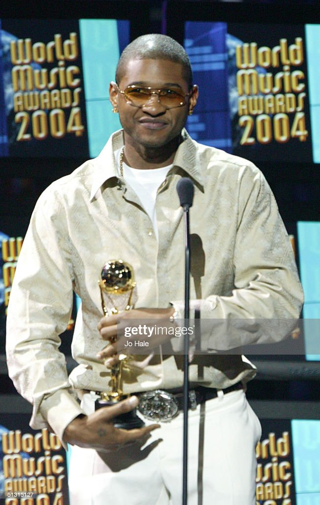 Usher accepts his award on stage at the 2004 World Music Awards at the Thomas & Mack Centre on September 15, 2004 in Las Vegas.