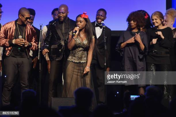 Usher Alfre Woodard and Gloria Steinem perform onstage during Robert F Kennedy Human Rights Hosts Annual Ripple Of Hope Awards Dinner on December 13...
