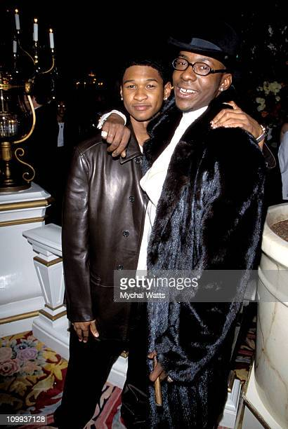 Usher and Bobby Brown during The 40th Annual GRAMMY Awards Arista Records PreGRAMMY Party at Beverly Hills Hotel in New York City New York United...