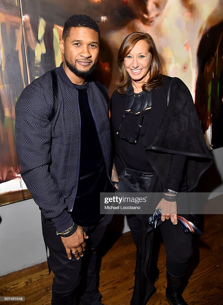 Usher (L) and designer Donna Karan attend Art For Social Justice, Usher Raymond IV, Daniel Arhsam and TIDAL debut Chains at Urban Zen on January 29, 2016 in New York City.