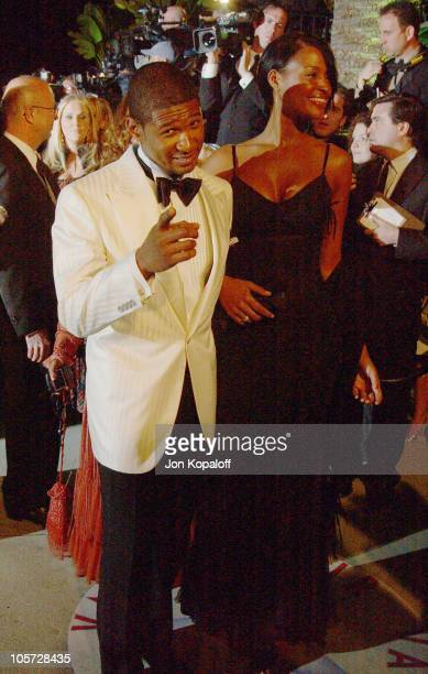 Usher and Eishia Brightwell during 2005 Vanity Fair Oscar Party at Mortons in Los Angeles California United States