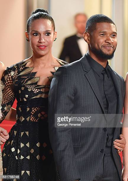 Usher and fiance Grace Miguel attend the screening of Hands Of Stone at the annual 69th Cannes Film Festival at Palais des Festivals on May 16 2016...