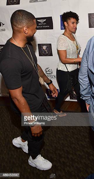 Usher and Grace Miguel attend The Grass Is Greener at Bowlmor lanes on September 3, 2015 in Atlanta, Georgia.