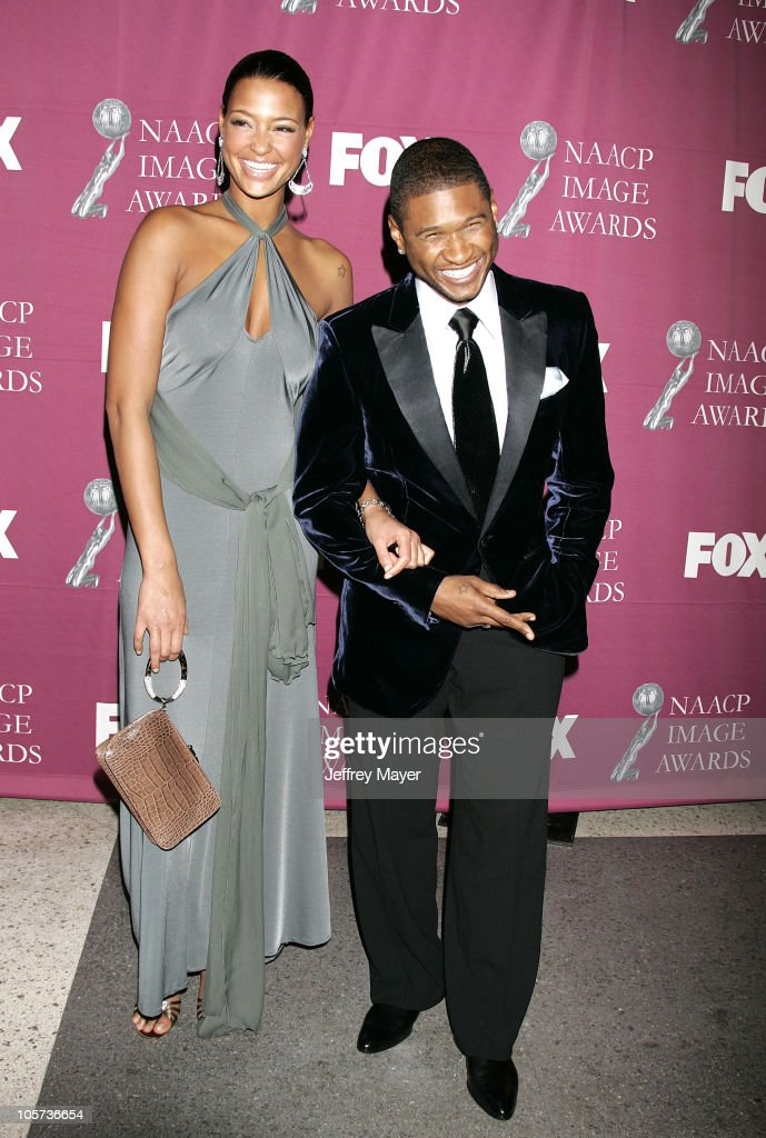 Usher and guest during The 36th Annual NAACP Image Awards - Arrivals at Dorothy Chandler Pavilion in Los Angeles, California, United States.