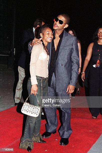 Usher and his new unidentified girlfriend arrive at Tavern on the Green September 7 2001 for the Michael Jackson concert after party in New York City
