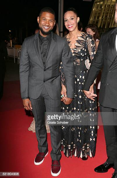 """Usher and his wife Grace Miguel leave the """"Hands Of Stone"""" premiere during the 69th annual Cannes Film Festival at the Palais des Festivals on May..."""
