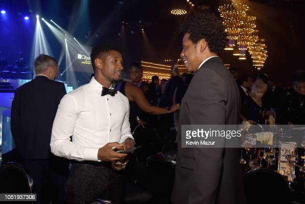 Usher and JayZ attend the City of Hope Spirit of Life Gala 2018 at Barker Hangar on October 11 2018 in Santa Monica California