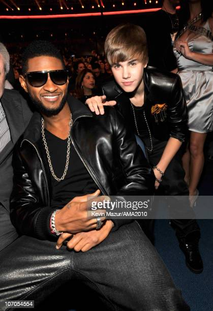 Usher and Justin Bieber in the audience at the 2010 American Music Awards held at Nokia Theatre LA Live on November 21 2010 in Los Angeles California