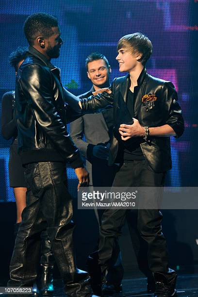 Usher and Justin Bieber on stage at the 2010 American Music Awards held at Nokia Theatre LA Live on November 21 2010 in Los Angeles California