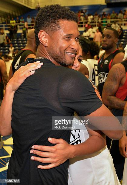 Usher and Laura Govan Basketball Wives of LA during Neuro Drinks At LudaDay Weekend Celebrity Basketball Game at GSU Sports Arena on September 1 2013...
