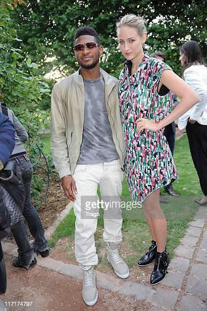 Usher and Leelee Sobieski during the Adam Kimmel Menswear Spring/Summer 2012 show as part of Paris Fashion Week on June 23 2011 in Paris France
