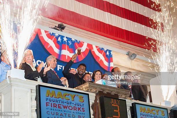 Usher and Macy's 4th Of July fireworks executive producer Amy Kule ring the NYSE closing bell at the New York Stock Exchange on July 3 2013 in New...