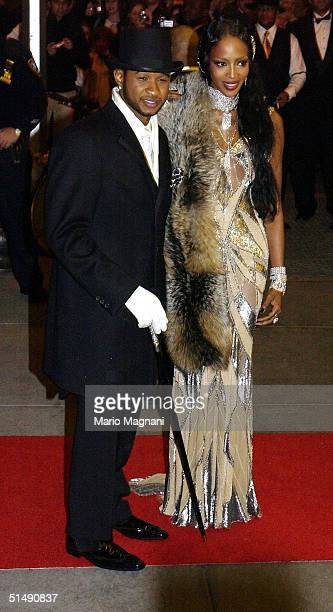 Usher and Naomi Campbell arrive at the Rainbow Room for Usher's 26th birthday party October 17 2004 in New York City Photo by Mario Magnani/Getty...