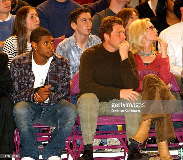 Usher and Stephanie March guest during New York Knicks vs Sacramento Kings Courtside at Madison Square Garden in New York City New York United States