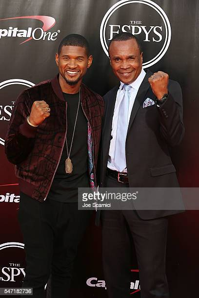Usher and Sugar Ray Leonard arrive at The 2016 ESPYS at Microsoft Theater on July 13 2016 in Los Angeles California