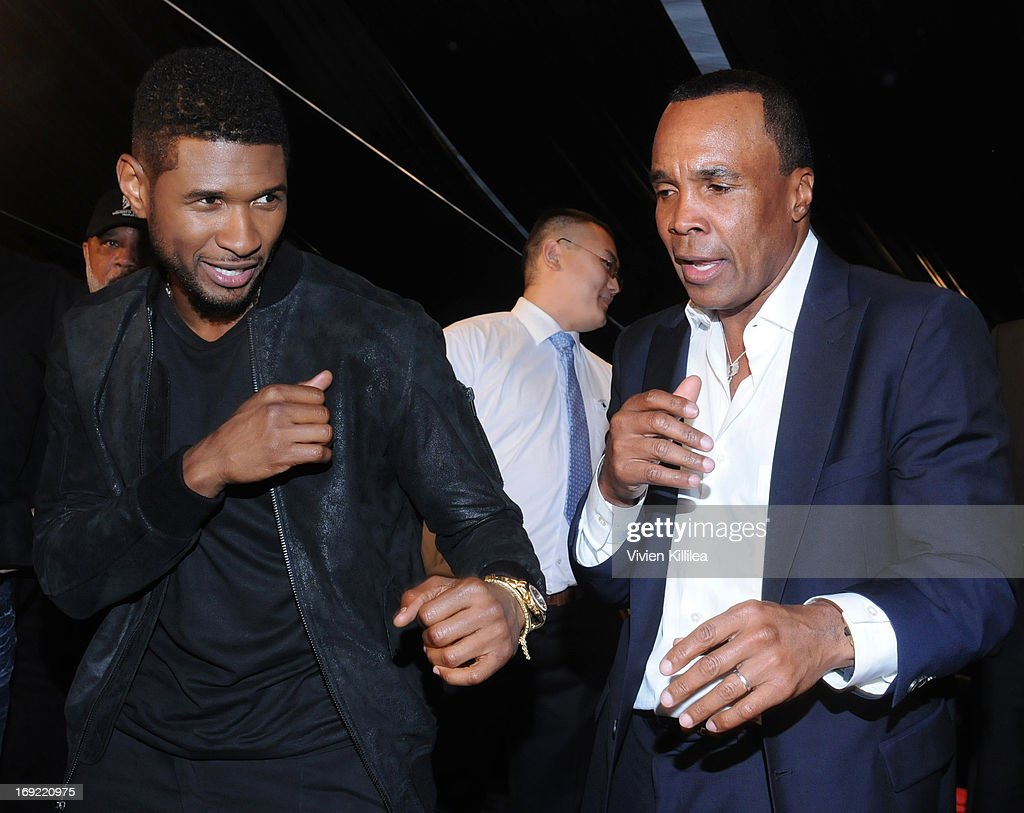 Usher and Sugar Ray Leonard play fight at B. Riley & Co. & The Sugar Ray Leonard Foundation Present The 4th Annual 'Big Fighters, Big Cause' Charity Fight Night To Benefit Juvenile Diabetes at Santa Monica Pier on May 21, 2013 in Santa Monica, California.