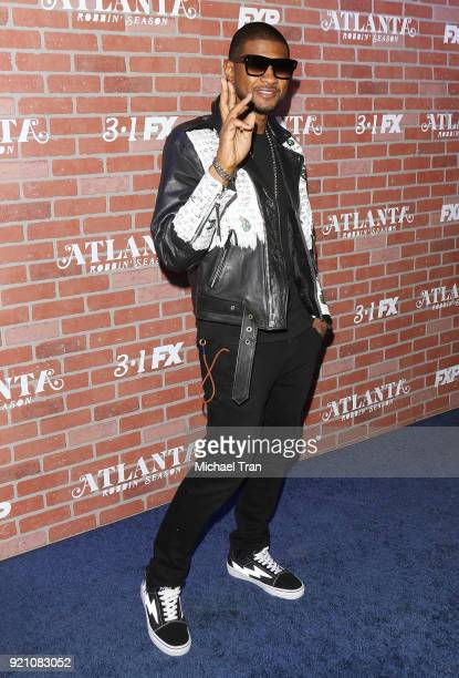 Usher arrives at FX's Atlanta Robbin' Season Los Angeles premiere held at Ace Theater Downtown LA on February 19 2018 in Los Angeles California