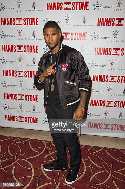 Usher arrives at the screening of the Weinstein Company's 'Hands of Stone' at Pacific Theatres at The Grove on August 15 2016 in Los Angeles...