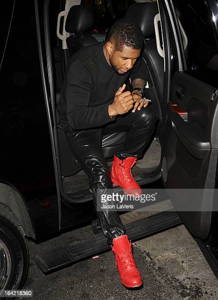 Usher attends NBC's 'The Voice' season 4 premiere at TCL Chinese Theatre on March 20 2013 in Hollywood California
